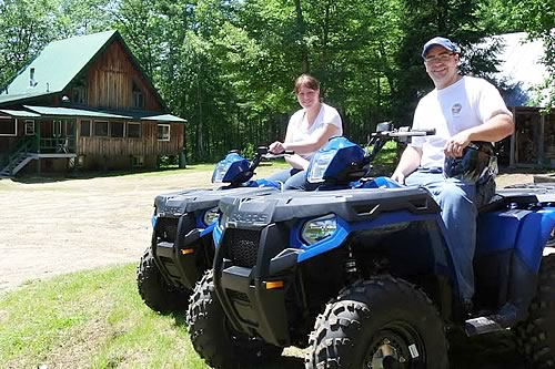 A Photo of your hosts Etienne and Kieran on ATVs in front of the lodge